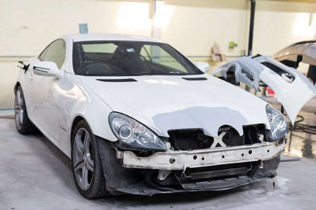 dirty car: Auto body repair series: White sport car waiting for repaint Stock Photo