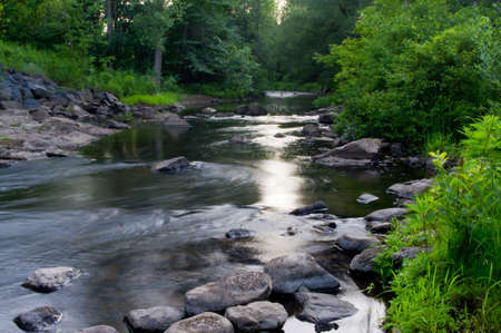 The Little AuSable River late in the day near sunset