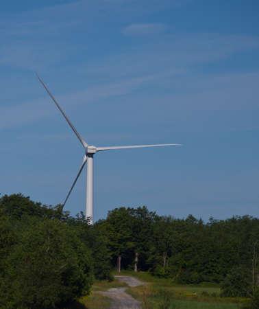 wind down: Wind Turbine down a remote dirt road Stock Photo