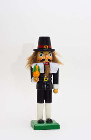 a Pilgrim Nutcracker against a white background