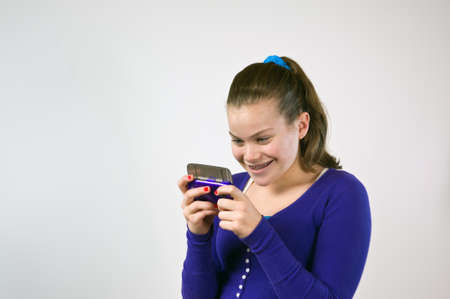 Young teen girl texting photo