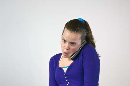 Teen girl talking on the telephone photo