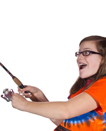 Teen Girl with fishing rod isolated against a white background photo