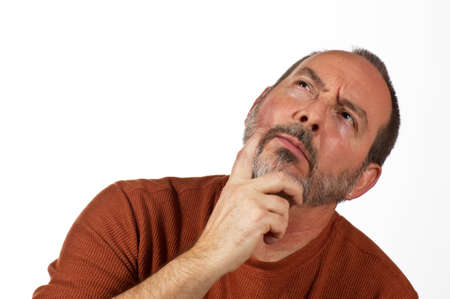 funny bearded man: middle aged man with hand on beard looking up thinking Stock Photo