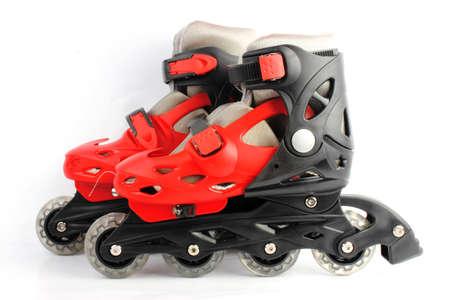 patines: Patines Rojo Negro coloreados aislados en blanco Foto de archivo