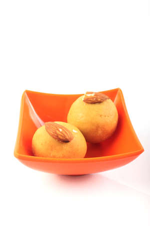 Laddu  Indian Sweet In Melamine Bowl  Isolated on White photo