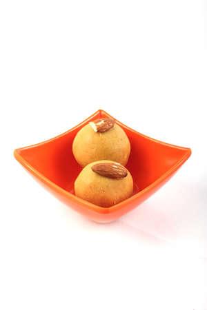 ramzan: Laddu  Indian Sweet In Melamine Bowl  Isolated on White