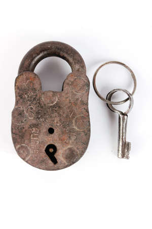 Old padlock and key  Isolated with clipping path photo