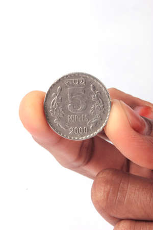 rupees: 5 indian rupees coin in Fingers Stock Photo