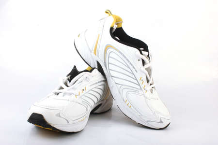 shoestrings: Sports Shoes Isolated on White