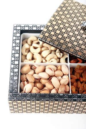 dry fruit: Nuts box on white background. Dry Fruit Box. Stock Photo