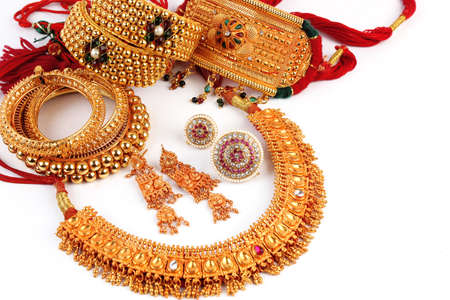 fashion jewellery: All Mix Indian Traditional Gold Jewellery Isolated On White Stock Photo