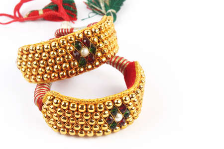 wristlet: Traditional Indian Gold Bangles Isolated on White