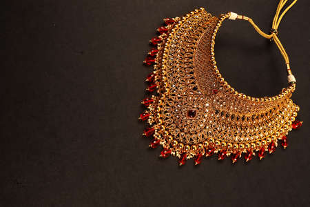Authentic Traditional Indian Jewellery Necklace On Dark Background. Wear in Neck in Wedding, Festivals And Other Occasion. Very Useful Image For Website, Printing & Mobile Application.
