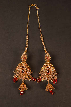 Authentic Traditional Indian Jewellery Earrings On Dark Background. Wear in Ears in Wedding, Festivals And Other Occasion. Very Useful Image For Website, Printing & Mobile Application.