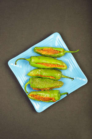 Delicious Mouth Watering Stuffed Green Chili With Gram Flour. Bharma Besan Mirchi. Stock Photo