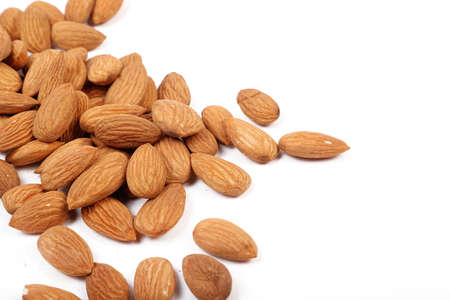 Group of almonds isolated on white.