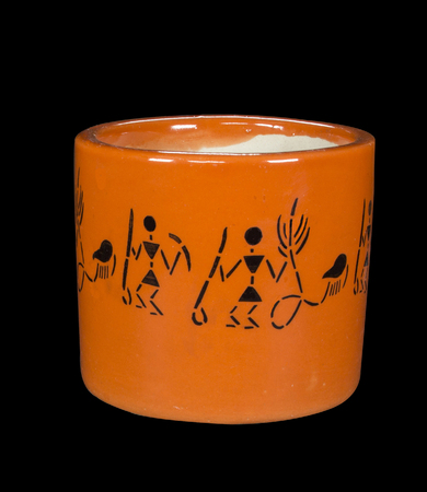 Round Orange Ceramic Pot for plant flower with tribal pattern on black background
