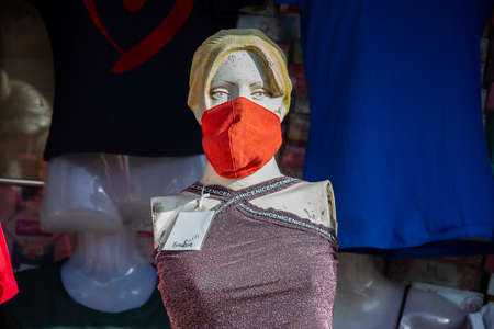 Jodhpur, Rajasthan, India - May 20 2020: Female Mannequin with mask on face. Shops are reopening after lock down restrictions due to the covid-19 pandemic, back to normal life with few safety measure.