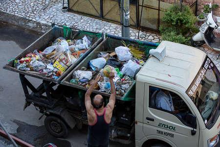 Jodhpur, Rajashtbn, India. 20th April 2020 , People dropping their garbage bag to van during the Lockdown due to the Covid-19 virus , corona virus