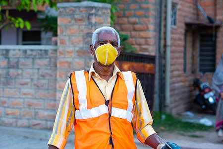 Jodhpur, Rajashtbn, India. 30 March 2020: Portrait of Indian cleaning service, old man wearing protective mask, coronavirus, covid-19 outbreak in india.