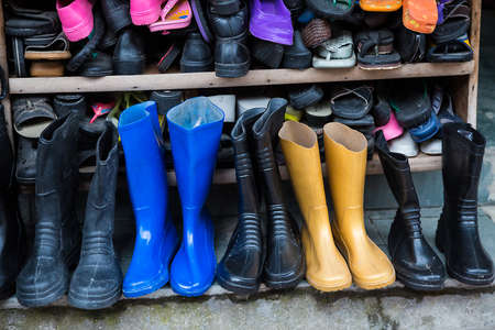 Rows of various winter boots, shoes and slipper, shop - Image