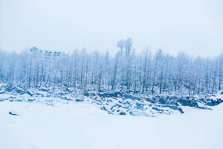 Beautiful winter landscape with forest , trees and rive covered with white snow, snowfall in Himalayan mountains - Image