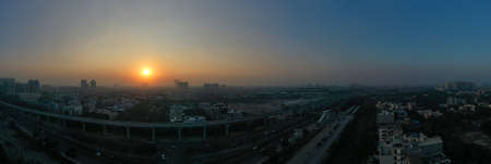 Panoramic aerial view of Noida,gurgaon, india, Rapid metro tracks in urban areas of Delhi NCR. Cityscape. evening sunset.
