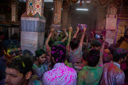 Jodhpur, rajastha, india - March 20, 2020: Group of indian people celebrating holi festival, face covered with colored powder.