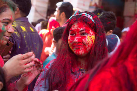 Jodhpur, rajastha, india - March 20, 2020: Young indian girl celebrating holi festival, face covered with colored powder.