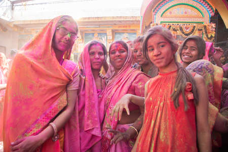 Jodhpur, rajastha, india - March 20, 2020: portrait of indian women wearing saree celebrating holi festival, face covered with colored powder.
