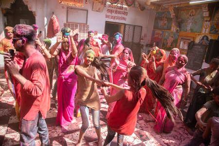 Jodhpur, rajastha, india - March 20, 2020: indian women celebrating holi festival with colored powder, dancing and enjoying. Editorial