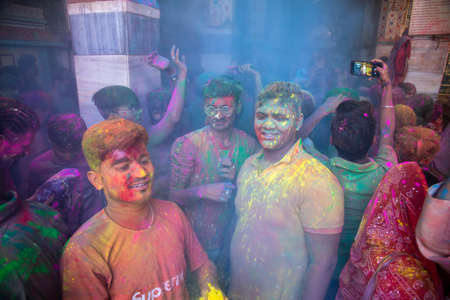 Jodhpur, rajastha, india - March 20, 2020: indian people celebrating holi festival, face smeared covered with colored powder.
