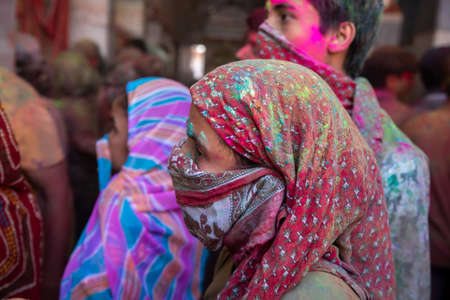 Jodhpur, rajastha, india - March 20, 2020: woman covering her face with scarf, playing holi festival.