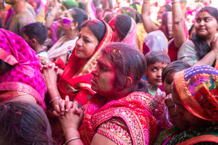 Jodhpur, rajastha, india - March 20, 2020: indian women celebrating Holi Festival. face covered with colored powder.