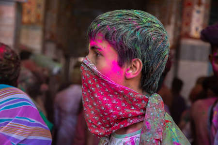 Jodhpur, rajastha, india - March 20, 2020: man covering her face with cloth, playing holi festival.