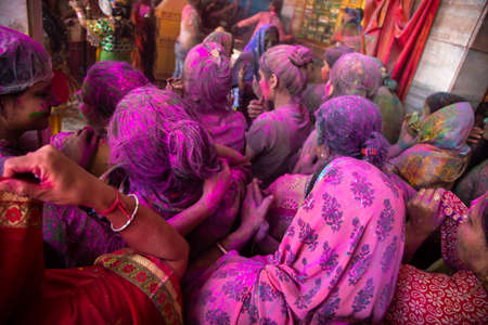 Jodhpur, rajastha, india - March 20, 2020: indian people celebrating holi festival, face covered with colored powder. background