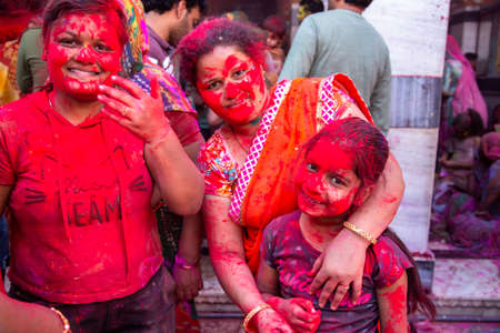 Jodhpur, rajastha, india - March 20, 2020: cute indian kids celebrating holi festival, face covered with colored powder.