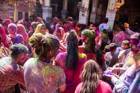 Jodhpur, rajastha, india - March 20, 2020: indian people celebrating holi festival, face covered with colored powder.