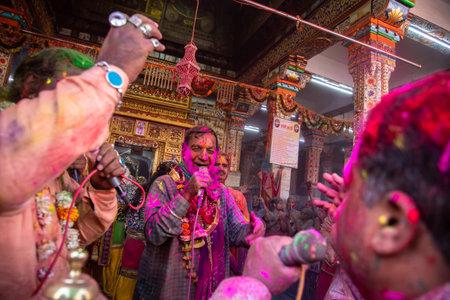 Jodhpur, rajastha, india - March 20, 2020: indian people singing dancing celebrating holi festival throw colored powder. Editorial