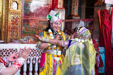 Jodhpur, rajastha, india - March 20, 2020: People Performing lord krishna and and gopi sattriya dance, happy janmashtami festival concept background, playing holi. Editorial
