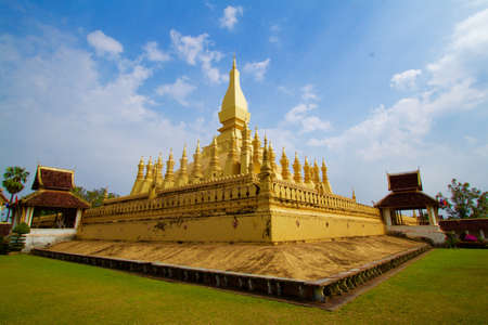 interspersed: A large golden pagoda interspersed with blue sky.