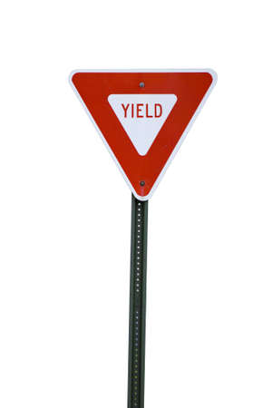 Red yield sign cut out against white photo