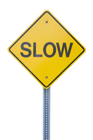 Yellow slow sign cut out against white photo