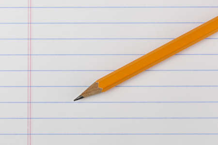 A yellow pencil on notebook paper Stock Photo - 9736090