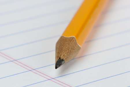A yellow pencil on notebook paper Stock Photo - 9736087
