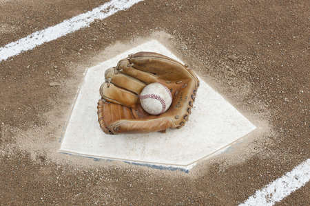 A baseball glove on home plate