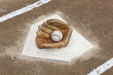 A baseball glove on home plate photo