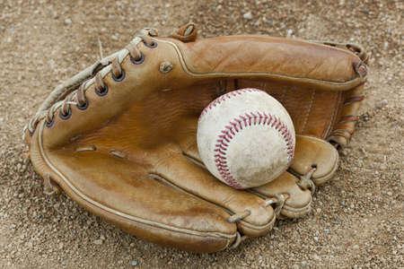 A baseball glove in a baseball diamond photo