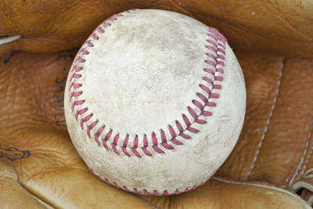 A baseball in a baseball glove photo